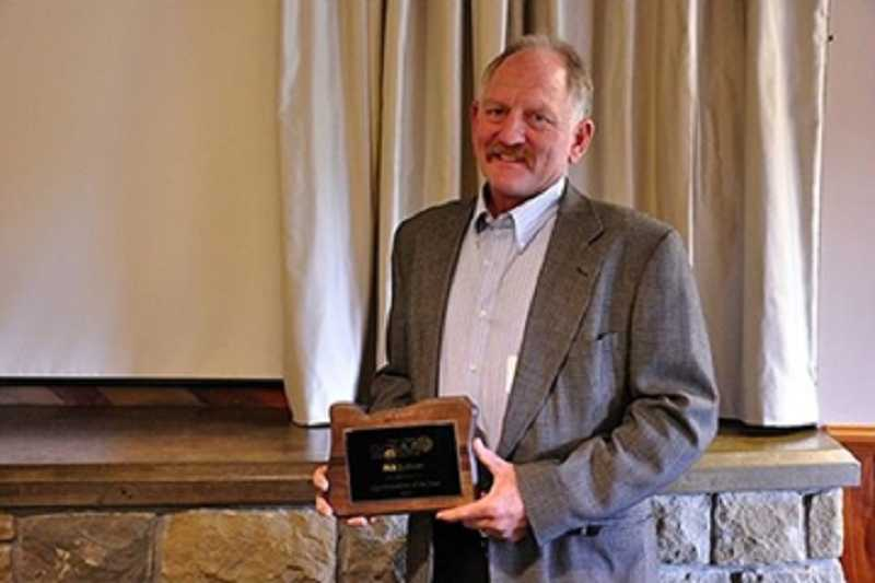 by: COURTESY OF SUMMERFIELD CIVIC ASSOCIATION - FIRST ON THE COURSE - Rick Sullivan holds the plaque he won in 2013 from the Oregon Chapter of the Golf Course Superintendents Association of America.