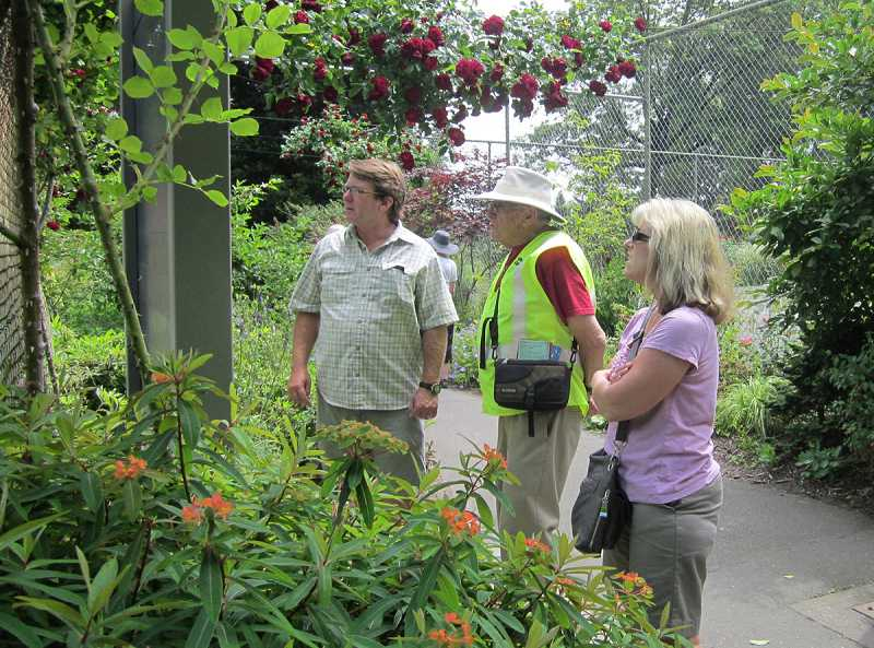 by: BARBARA SHERMAN - MAKING FRIENDS FROM ALL OVER - As Bob Klum leaves the Washington Park International Rose Test Garden and walks towards his vehicle, a couple asks for help trying to find a location on a map by the tennis courts.