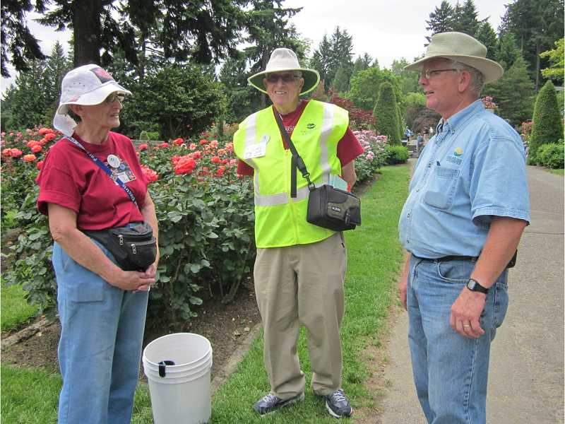 by: BARBARA SHERMAN - APPRECIATIVE BOSS - Pat and Bob Klum (left) chat with Harry Landers, the rose garden's curator, botanic specialist and only employee, who said he could not do his job without the help of volunteers like the Klums.