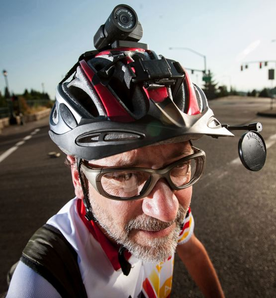by: PAMPLIN MEDIA GROUP: CHRISTOPHER ONSTOTT - Andrew Holtz wears a video camera on his bike helmet to capture cars breaking the law.