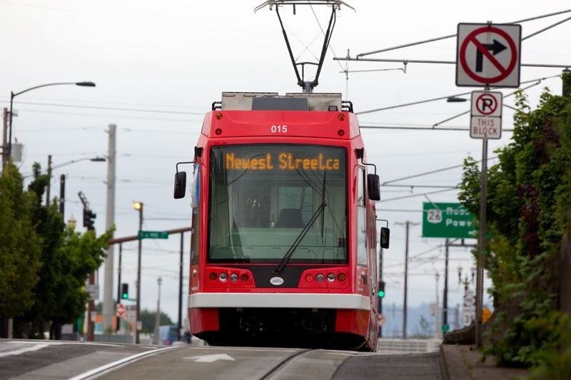 by: TRIBUNE PHOTO: CHRISTOPHER ONSTOTT - A new street car made by United Streetcar of Clackamas will be part of the new eastside Portland streetcar line that opened Saturday morning.