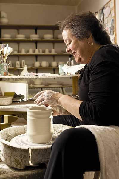 by: TIMES PHOTO: JAIME VALDEZ - Artist Deborah Shapiro shapes a spoon holder at her studio in Tigard.
