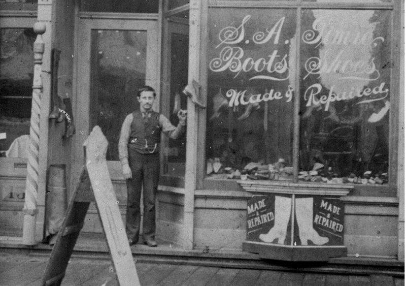 by: SUBMITTED PHOTO - SUBMITTED PHOTO Sven Gimre in front of the first Gimre's Shoes store, located in Astoria, circa 1892.