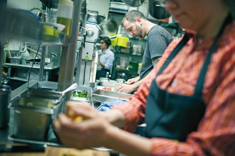 by: TRIBUNE PHOTO: CHRISTOPHER ONSTOTT - Cooks Matt Alspach and Tamara Edens prep food in the kitchen of Grain & Gristle.