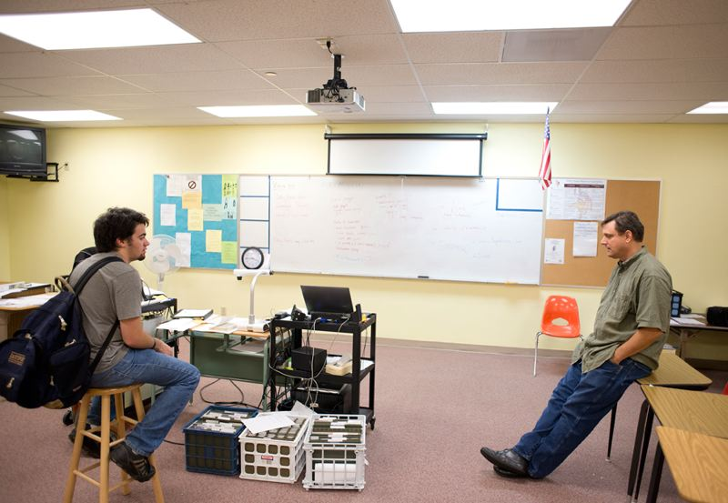 by: NEWS-TIMES PHOTO: CHASE ALLGOOD - Viking log instructor Mike Mlynski plans news coverage with writer Genny Gregory