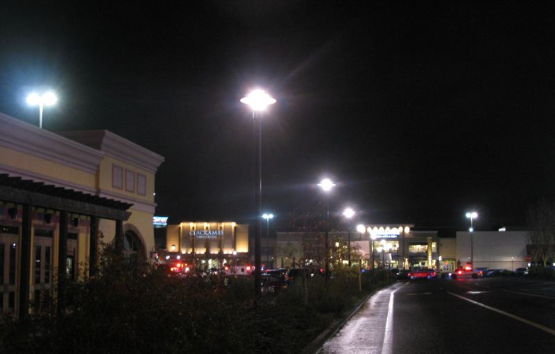 by: PAMPLIN MEDIA GROUP: RAYMOND RENDLEMAN - Hundreds of police vehicles seal off Clackamas Town Center Mall on Tuesday evening.