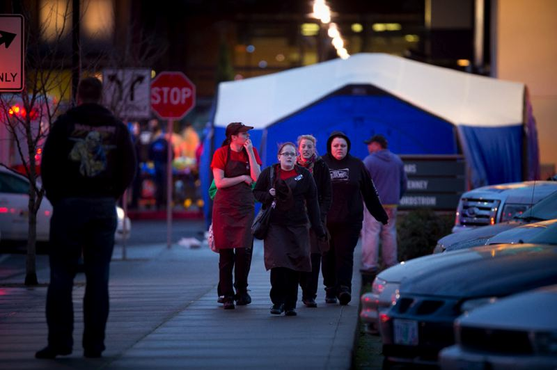 by: PAMPLIN MEDIA GROUP: CHRISTOPHER ONSTOTT - Clackamas Town Center store employees were led from the shopping center by law enforcement officers after the Tuesday afternoon shooting.