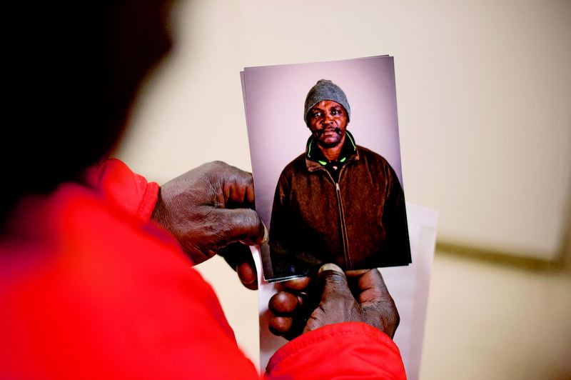 by: TRIBUNE PHOTO: CHRISTOPHER ONSTOTT - Willy Scruggs holds his portrait, which he plans to send to his sister. Some choose to give the photos as gifts; others plan to hold on to them as keepsakes.