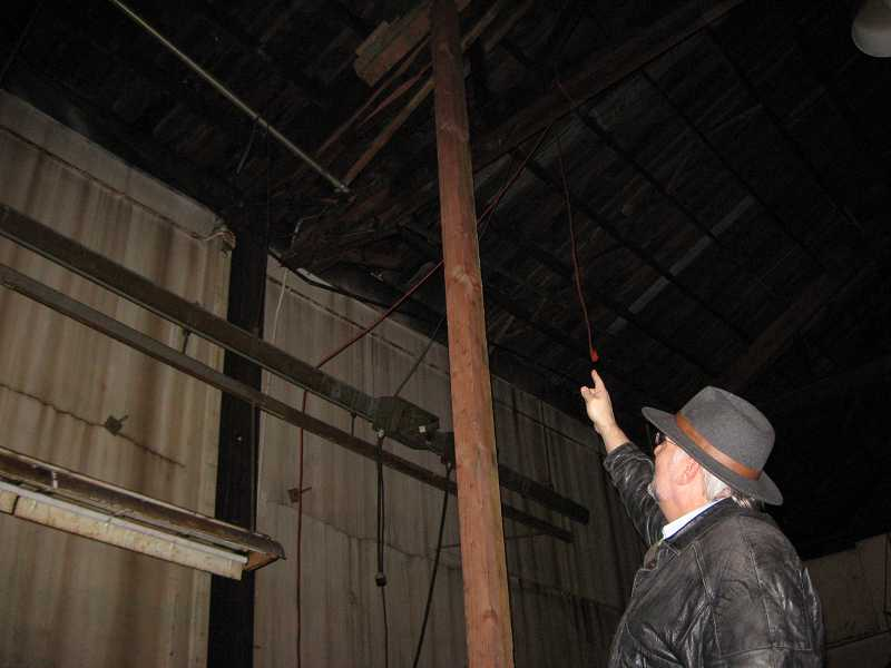 by: RAY PITZ - NASTY BREAK - City Engineer Bob Galati points to a bow truss that has failed (just to the left of the beam, above the concrete wall).