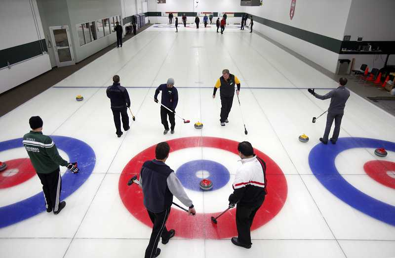 by: TIMES PHOTO: JONATHAN HOUSE - Curlers at the Evergreen Curling Club enjoy one of the West Coast's only dedicated curling rinks.