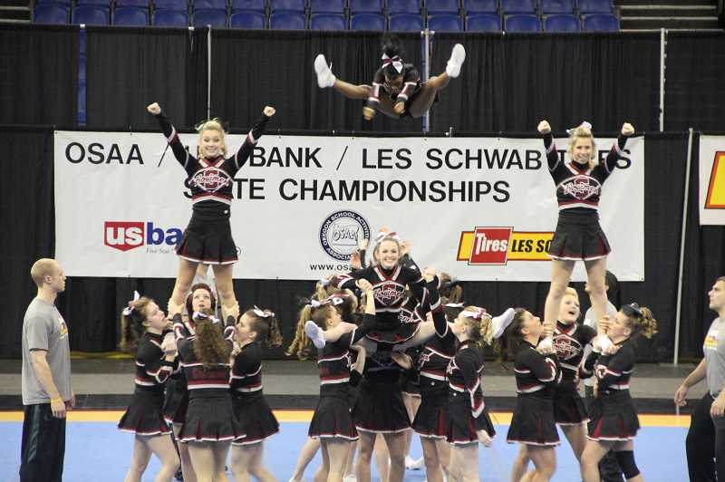 by: COURTESY OF TRACIE HARBICK - Sherwood High cheerleaders com;ete Feb. during the OSAA's annual competition held at Veteran's Memorial Coliseum. The team placed seventh in its division.