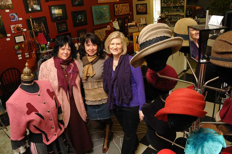by: REVIEW PHOTO: VERN UYETAKE - Lots of everything is being offered at Maison des Artistes on Avenue A in Lake Oswego. From the left are owners KT Bronson, Cindy Ayala and Chris Shimpach.