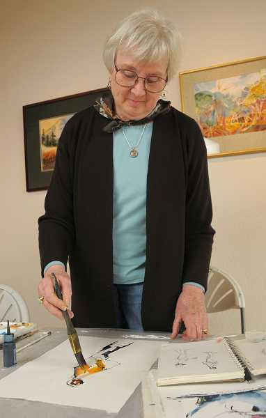by: VERN UYETAKE - Deborah Marble demonstrates watercolor painting last week at Museum 510, a gallery space in downtown Lake Oswego.