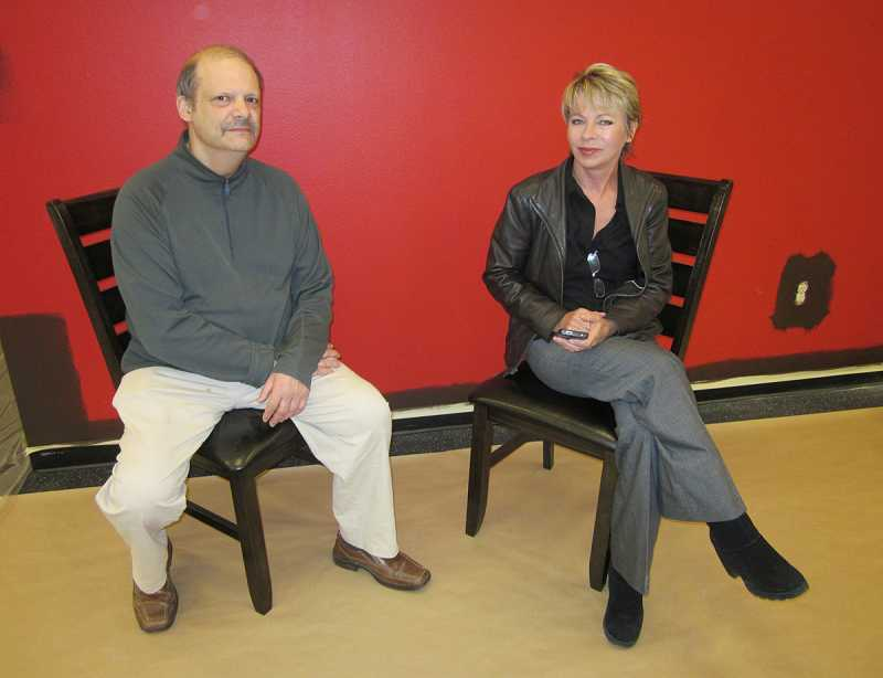 by: BARBARA SHERMAN - FILLING A NICHE - Mike Blum and Petra Garton, sitting in the former Anytime Fitness facility that is undergoing major remodeling, will run the King City Social Club in the King City Plaza, providing a variety of games, TV viewing, food and drinks.