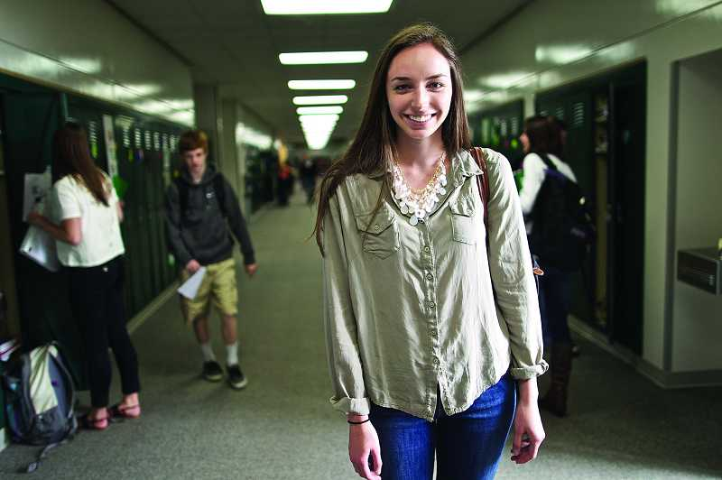 by: TIMES PHOTO: JAIME VALDEZ - Mariel Klein, a senior at Jesuit High School, takes a break between classes in the hallway in school between classes.