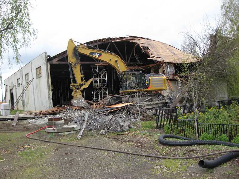 by: RAY PITZ - Tearing down the old machine shop in Old Town Sherwood began in earnest Monday morning. By noon, about one-quarter of the facility had been taken down.