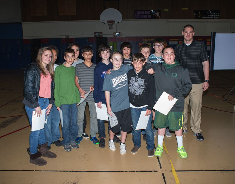 by: NEWS-TIMES PHOTO: CHASE ALLGOOD - Members of the Neil Armstrong Middle School 7B basketball team pose for a few photos during an assembly last week, organized to honor their outstanding sportsmanship.