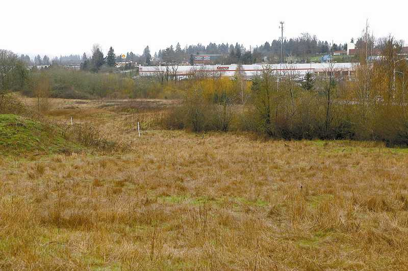 by: TIMES PHOTO: JAIME VALDEZ - The empy lot near the Tigard Costco will soon be home to a large Walmart supercenter. The store and several road construction improvements are set to begin this spring.