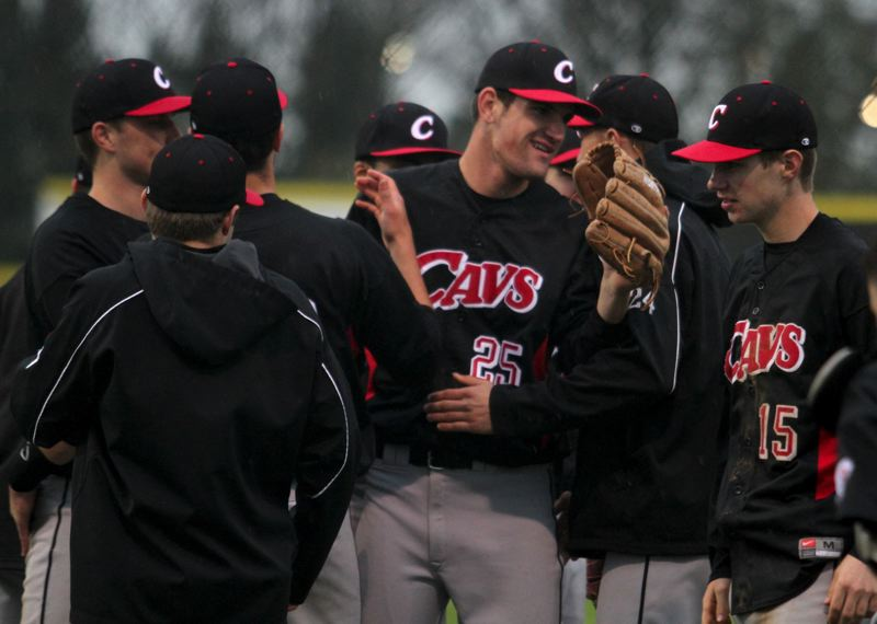 by: JONATHAN HOUSE - Clackamas relief pitcher Taylor Stinson (25) celebrates with his teammates after Fridays 4-2 win at Oregon City. The Cavaliers swept the defending state champs in three games and improved to 12-1 on the 2013 season with the wins.