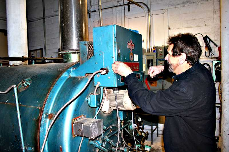by: TONY AHERN - Maintenance worker Bill Timoshuk checks one of the boilers in the Culver School District. The aging boilers break down on a regular basis. A district bond levy, up for a vote May 21, seeks to install a more reliable and economic heating system, among other improvements.