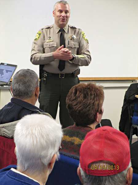 by: JOHN BOWLER - Deschutes County Sheriff's Office Capt. Shane Nelson discusses the office's role at the Ranch with residents on Monday.