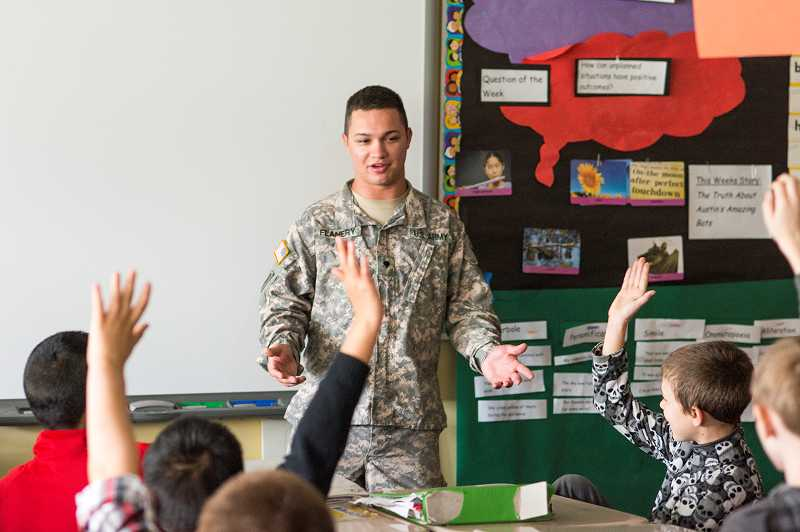by: NEWS-TIMES PHOTO: CHASE ALLGOOD - Spc. Joe Flanery thanks the fifth-gradersin Melissa Timms class for the letters they wrote to him while he was in Kuwait. The letter arrived two days before his birthday.
