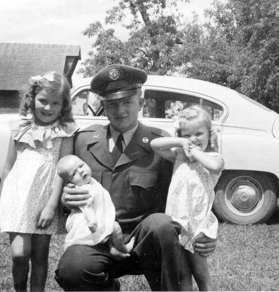 by: COURTESY PHOTO: GENE EVERS - Chinese interrogators found this photo of Gene Evers and his three nieces in Evers billfold and tried to use it during interrogation, assuming the girls were his daughters and threatening to kill them.