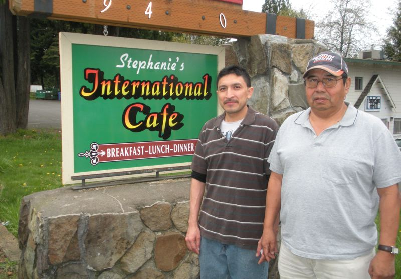 by: POST PHOTO: JIM HART - Standing beside the new roadside sign is business owner Carlos Cob, left, and his adviser, Jose Peralta. The restaurant chefs have moved from the large venue just east of the Sandy Library, and now they are in more cozy quarters just east of City Hall. POST PHOTO: JIM HART