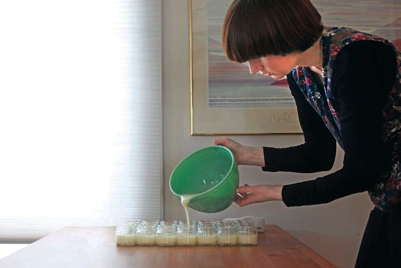 by: PAMPLIN MEDIA GROUP: JONATHAN HOUSE - Jaime Schmidt pours ingredients into jars of  Schmidts Deodorant, which she makes at her Portland home. She uses nontraditional scents such as cedarwood and juniper, and ylang-ylang and calendula.