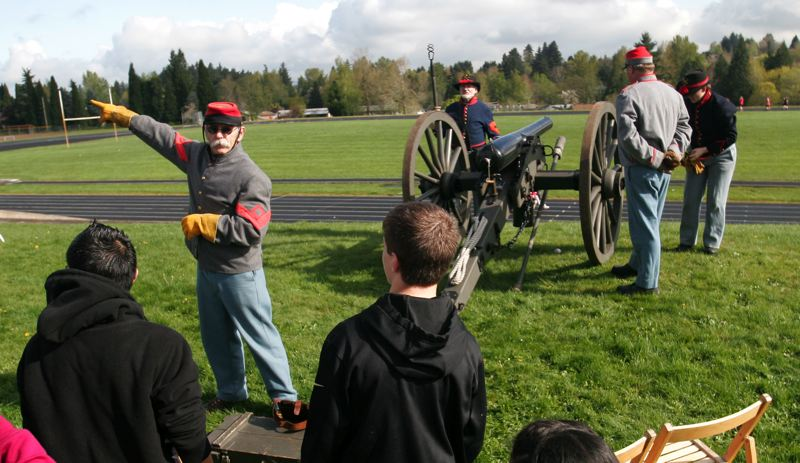 by: OUTLOOK PHOTO: JIM CLARK - John Leckie, portraying a southern artillery 1st Sergeant, explains the intricacies of a Civil War artillery unit.