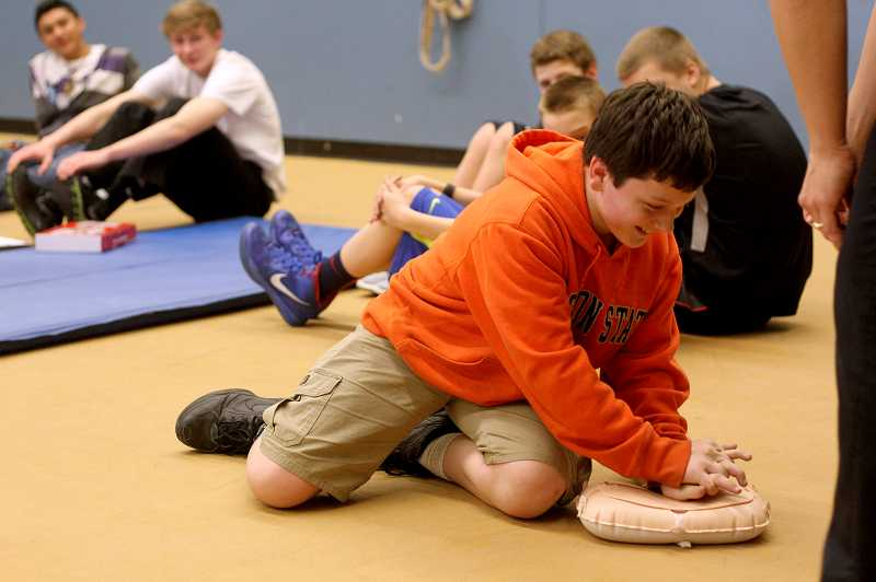 by: TIMES PHOTO: JONATHAN HOUSE - Kordell Fink practices hands-free CPR technique to the tune of 'Stayin' Alive.'