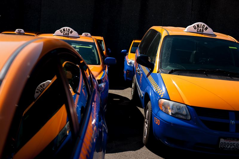 by: TRIBUNE PHOTO: CHRISTOPHER ONSTOTT - Portland's newest taxi company, 50-car Union Cab, hits the road this week with its fleet of 50 Prius sedans that company president Kedir Wako says will be more visible in city neighborhoods.