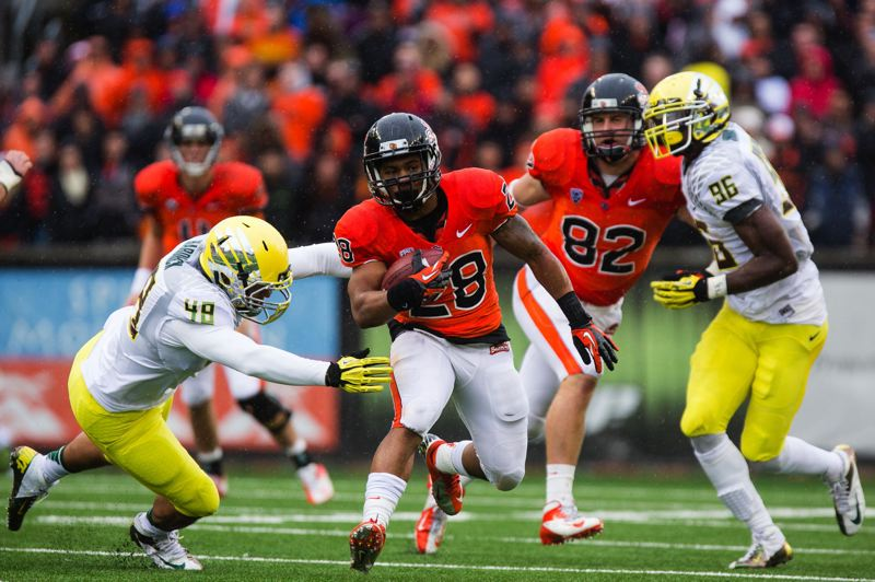 by: TRIBUNE FILE PHOTO: CHRISTOPHER ONSTOTT - Terron Ward, rushing in last year's Civil War game with Oregon, is one of at least two players in line for major carries as the Oregon State Beavers go through spring practices and look ahead to the 2013 season.