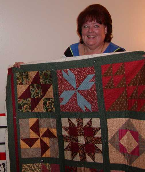 Dana Henley, the club president and event organizer,  shows one of her quilts.