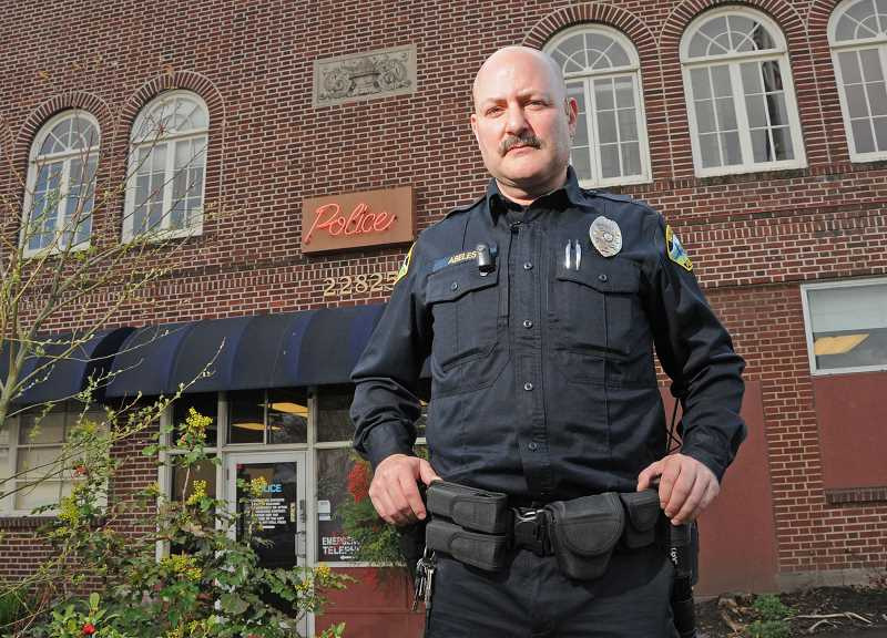 by: VERN UYETAKE - Jim Abeles stands outside the West Linn police station.