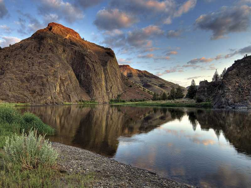by: GREG BURKE - Cathedral Rock rises above the John Day River, the eastern boundary of the proposed wilderness, at sunrise.