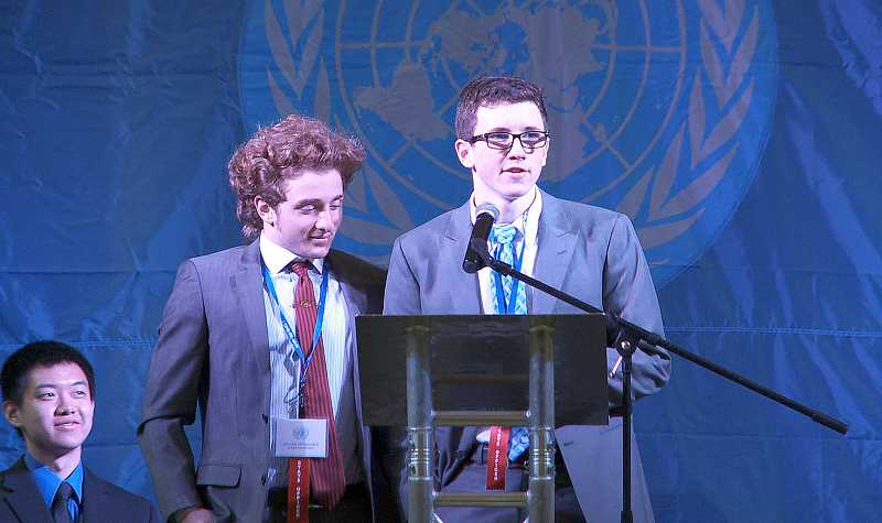 by: SUBMITTED PHOTO: JES WEBB - Lakeridge students Matt White, right, and Julian Heninger were leaders in the Model United Nations conference in Eugene. Westview High School student Frank Wang, seated, was the secretary general at the event.