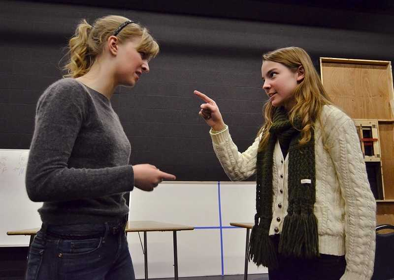 by: REVIEW PHOTO: VERN UYETAKE - Lakeridge High School students Mandy Wade, left, plays Olive, and Lea Zawada is Florence in the spring theater production of 'The Odd Couple.'