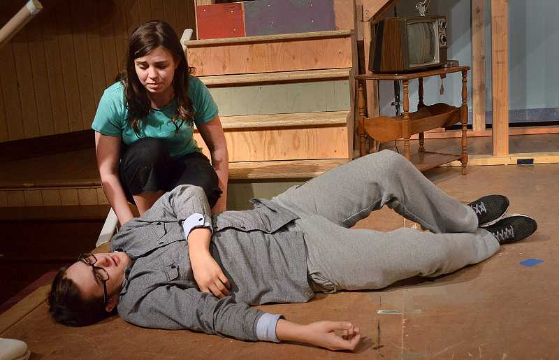 by: REVIEW PHOTO: VERN UYETAKE - Amy Davis as Belinda checks out Caden Reed as Roger who has just passed out in the production of 'Noises Off.'