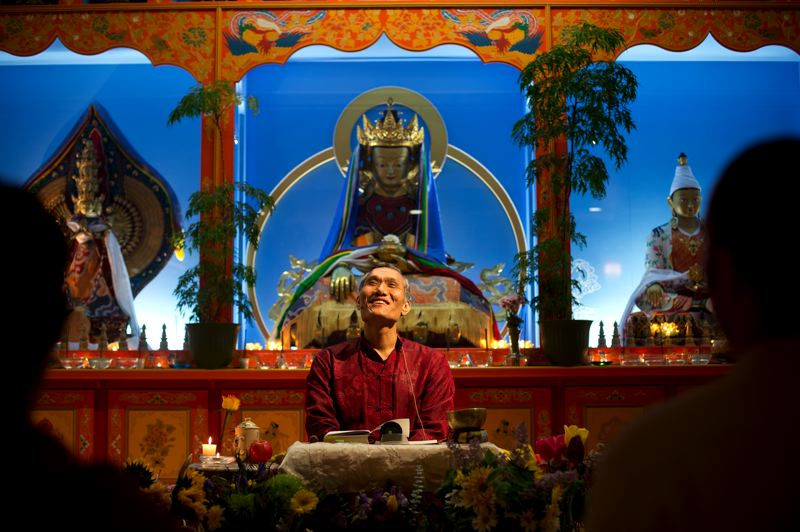 by: TRIBUNE PHOTO: CHRISTOPHER ONSTOTT - Humor is frequently a part of the Thursday evening service conducted by Yangsi Rinpoche, president of Maitripa College in Southeast Portland. Services draw a mix of ages but few Asians.