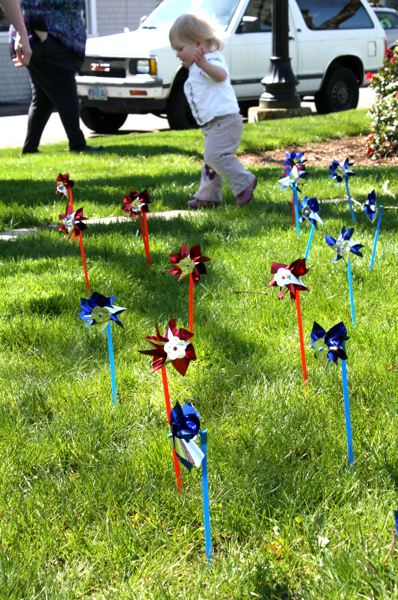 by: SPOTLIGHT PHOTO: KATIE WILSON - Olivia Garrett, 18 months, toddles past pinwheels set up to represent Columbia County children in the foster care system at an event sponsored by CASA for Kids and the Amani Center April 17.