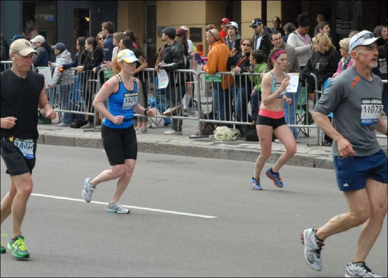 by: COURTESY: BOB LEONARD - Kyle Kersey is on the far right of this picture taken by hobby photographer Bob Leonard of Taunton, Mass., who sent the image to law enforcement in  hopes it would help identify the two men accused of the April 15 bombings at the Boston Marathon. The suspects are in the crowd between the two women running.
