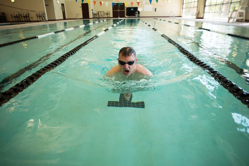 by: NEWS-TIMES PHOTO: CHASE ALLGOOD - Hillsboro Police Lt. Richard Goerling does his morning laps in the pool at Hawthorn Athletic Club. Its part of a program to enhance physical, mental and emotional wellness he plans to bring to his own department this spring and to other agencies next year.