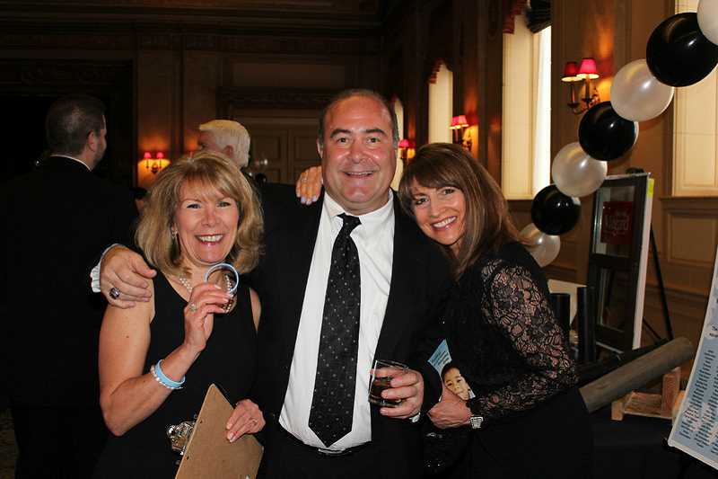 by: SUBMITTED PHOTO - Those attending the Home Builders Foundation Black and White Gala included, from left, Patti Cowdery, board member and event chairman Tim Nacrelli and procurement chairwoman Melanie Breedlove.