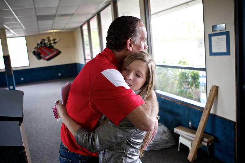 by: TIMES PHOTO: JAIME VALDEZ - Malibu Raceway Owner Kevin O'Connell hugs former employee Ariana Gittins, 18, after she picked up her last paycheck and paperwork on Tuesday.