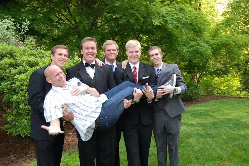 by: SUBMITTED PHOTO: DERRITH LAMBKA - Lakeridge varsity basketball players, all seniors, prep for prom, from left: Lakeridge varsity basketball players Michael Walker, Patrick Jaco, Nate Lambka, Madison Pihl and Rick Hiller, and holding coach Dane Walker.