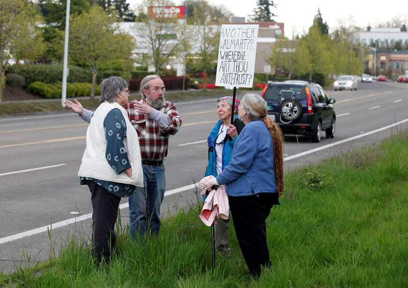 by: TIMES PHOTO: JONATHAN HOUSE - Noreen Bibbons, Jim Long, Ruth Crichton, and Karen Crichton protest at the proposed site of a new Walmart on 72nd and Dartmouth in Tigard. The group is part of a growing opposition to the Walmart, which is set to break ground as early as this month.