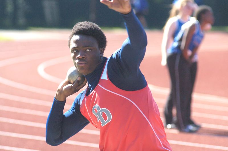 by: PAMPLIN MEDIA GROUP: DAVID BALL - David Douglas senior Samson Ebukam won the shot put and javelin events during Wednesday's dual-meet finale.