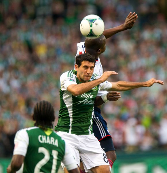 by: TRIBUNE PHOTO: CHRISTOPHER ONSTOTT - Diego Valeri of the Portland Timbers tries to play the ball in the air during Wednesday's 0-0 draw with the New England Revolution at Jeld-Wen Field.