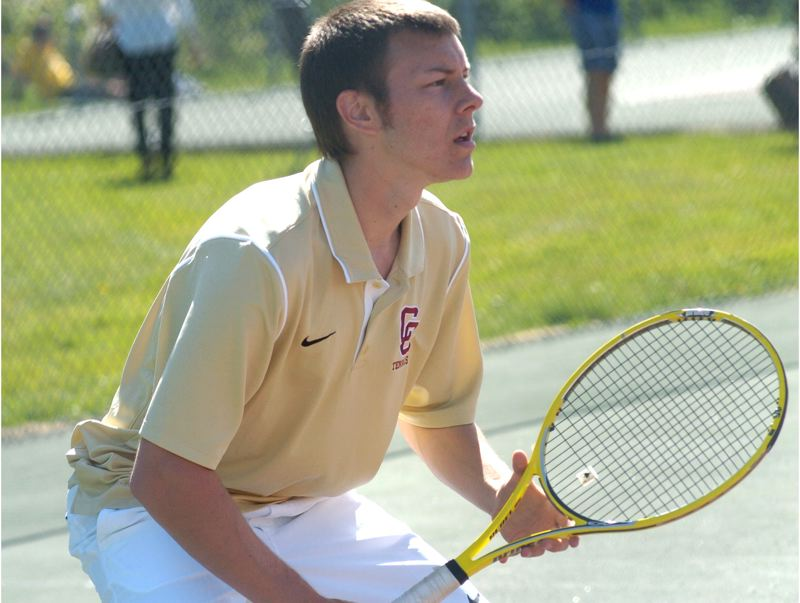 by: PAMPLIN MEDIA GROUP: DAVID BALL - Central Catholics Joe Palodichuk waits for a serve during his 6-4, 7-5 win in No. 1 singles Wednesday.